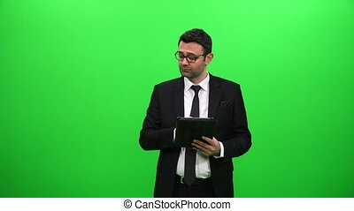Young Male Businessman Using Tablet with Green Screen