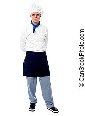 Young male chef posing casually