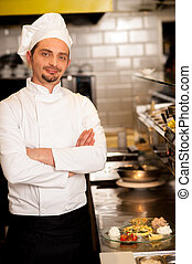Young male chef posing with confidence