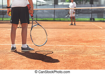 Young male child ready for tennis