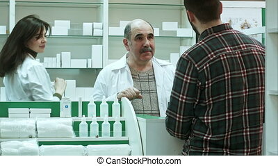 Young male customer buy medical products in a drugstore