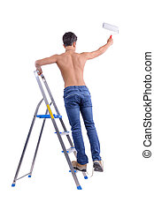 Young male decorator painting with a paint roller. - Young...