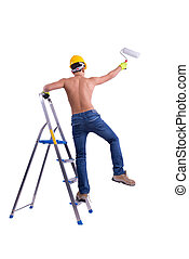 Young male decorator painting with a paint roller.