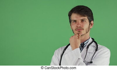 Young male doctor looking away thoughtfully