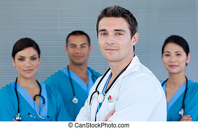 Young male Doctor with his team in the background