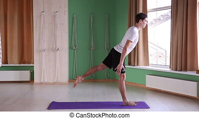 young  male doing yoga