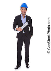 Young Male Engineer Holding Blueprint
