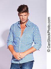 young male fashion model posing