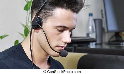 Young male home worker with headset