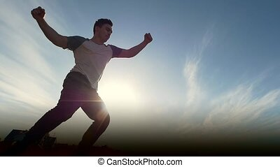 Young male Parkour tricker jumper performs amazing flips in...