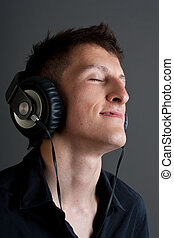 Young male person listening to music