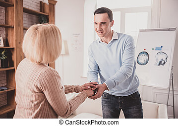 Young male person looking into eyes of his therapist