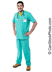 Young male physician posing casually