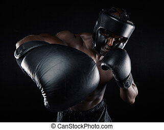 Young male practicing boxing - Portrait of young male...