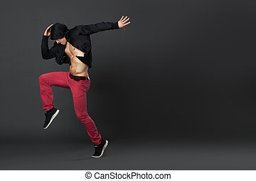 Young male professional dancer dancing in studio. - Young...