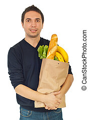 Young male shopping groceries