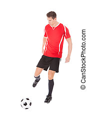 Young Male Soccer Player Kicking Football