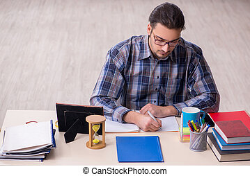 Young male student sitting in the classroom - Young student ...