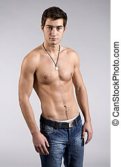 Young male underwear model on grey background