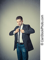 young man adjusting his suit