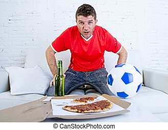 man alone stressed and anxious wearing team jersey watching football game on television
