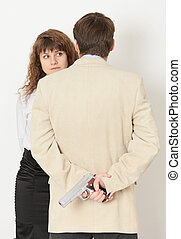 Young man and a beautiful woman. gun in hand