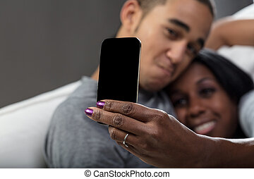 young man and a woman using mobile phones