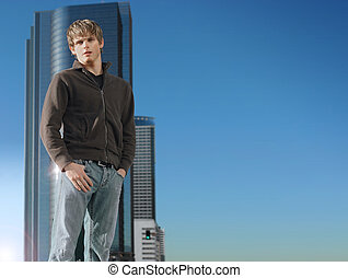 Young man and building with sky