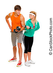 Young man and fitness girl lifting a dumbbell isolated on...