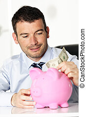 young man and piggy bank