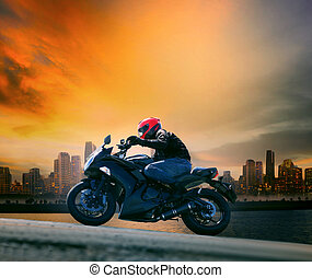 young man and safety suit riding big motorcycle against beautifu