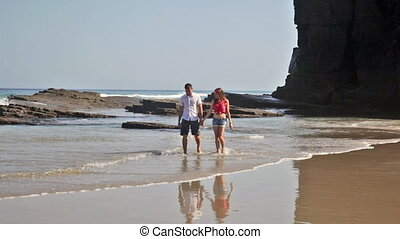 young man and the girl go on the seashore and talk