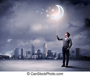 Young man and the moon symbol