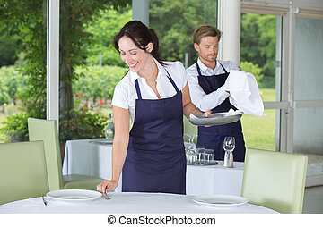 young man and woman at catering service in restaurant