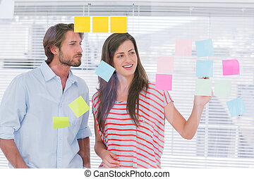 Young man and woman brainstorming together