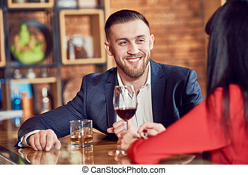 young man and woman celebrating in restaurant
