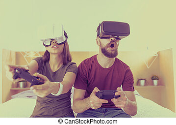 e3824c0e68e Young man and woman competing in VR glasses. Oh no. Young pretty man and  woman competing in VR glasses playing video games