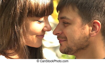 Young man and woman hug each other at the sun. Happy loving couple at the honeymoon enjoying romantic moment . Love story. Valentines day concept