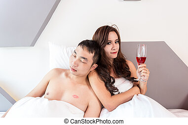 Young man and woman in bed. Couple