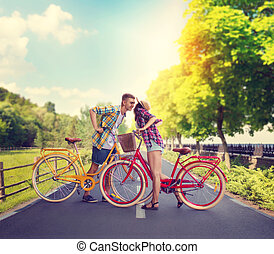 Young man and woman, romantic date on bicycles