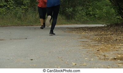 young man and woman runners