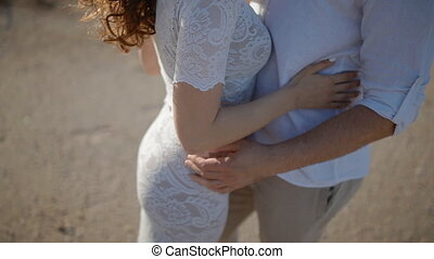 Young man and woman touch hands of each other