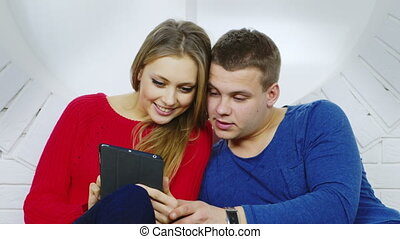 Young man and woman using a tablet