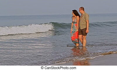 Young Man and Woman Walk in Light Ocean Surf - VARKALA...