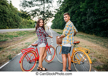Young man and woman with retro bikes