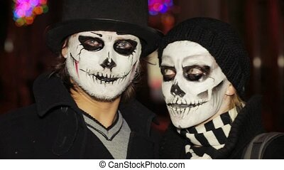 Young Man And Woman With Spooky Halloween Makeup - In the...