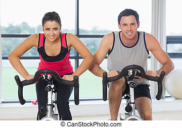 Young man and woman working out at - Portrait of a young man...