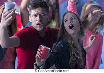 Young man and women dancing