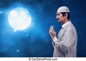Young man asian muslim prayer