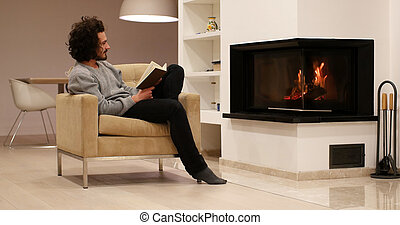 young man at home reading book